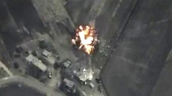 REFILE - ADDITIONAL RESTRICTIONA frame grab taken from footage released by Russia's Defence Ministry September 30, 2015, shows precise airstrikes carried out by the country's air force on Wednesday, against Islamic State (IS) ground positions in a mountainous area in Syria. Russian air strikes in Syria are targeting a list of well-known militant organisations, not only Islamic State, the Kremlin said on Thursday, a day after the launch of its aerial campaign opened up a volatile new phase in the conflict. Moscow had previously framed its campaign as primarily aimed at Islamic State militants, saying it feared Russian and other ex-Soviet citizens who belong to the group would shift their focus to their home countries if they were not stopped in Syria. But on Thursday, after the United States and rebels on the ground suggested Russian strikes had so far not focused on Islamic State, it said its operation was pitched more broadly.   REUTERS/Ministry of Defence of the Russian Federation/Handout   NO ARCHIVES.   THIS IMAGE HAS BEEN SUPPLIED BY A THIRD PARTY. IT IS DISTRIBUTED, EXACTLY AS RECEIVED BY REUTERS, AS A SERVICE TO CLIENTS.